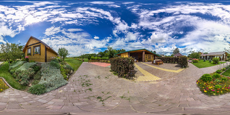 3D spherical panorama with 360 viewing angle. Ready for virtual reality or VR. Full equirectangular projection. Cold blue sky with green grass, garden, buildings and flowers at summer. 免版税图像 - 87801469