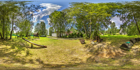 3D spherical panorama with 360 viewing angle. Ready for virtual reality or VR. Full equirectangular projection. Soft blue sky with green grass, garden, playground  at summer. Stock Photo