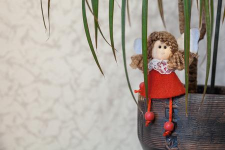 sitting red doll presiding like little girl