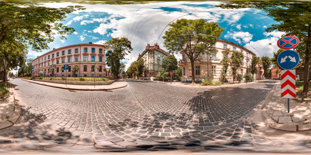 Lviv - summer, 2018: 3D spherical panorama with 360 degree viewing angle. Ready for virtual reality in vr. Full equirectangular projection. Old town. City center. Buildings with blue sky. Summer. Evening.