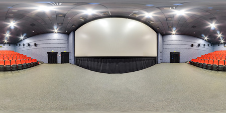 Moscow-2018: background. 3D spherical panorama with 360 degree viewing angle of cinema hall interior with red color seats and screen. Ready for virtual reality in vr. Full equirectangular projection. Banco de Imagens