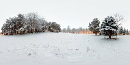 Image with 3D spherical panorama with 360 degree viewing angle. Snowy winter in park with trees at the evening. Burning lanterns. Full equirectangular projection. Ready for virtual reality in vr.