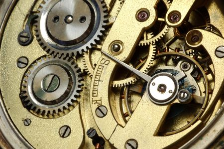 old watch: mechanism of old watch. close-up. two gears