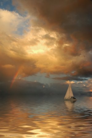 sun rise: Sailboat against a beautiful sunset with rainbow