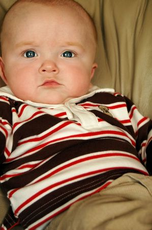 cute baby boy in a handsome shirt Stock Photo
