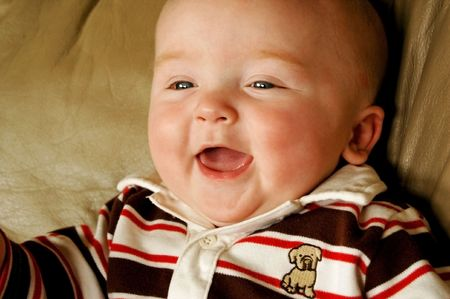 cute and chubby baby boy laughing