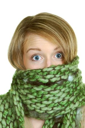 blond woman wrapped in a big green scarf