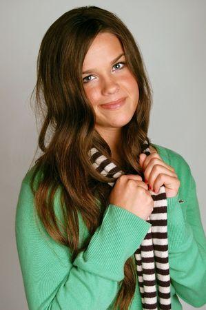 Sweet Brunette girl wearing a scarf