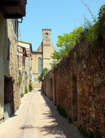 Narrow street in small italian town photo