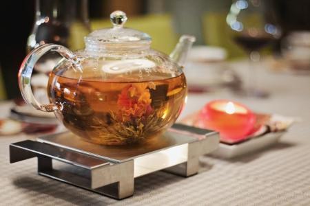 golden pot: Glass teapot with chinese tea Stock Photo