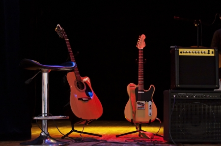 amps: Two guitars on the stage, waiting for the musicians Stock Photo