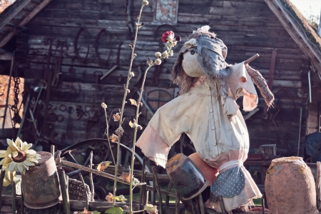 guard house: scarecrow with old wooden house in a background