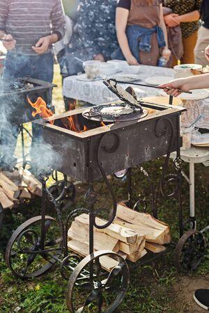 Baking waffles outdoors in an outdoor fair 版權商用圖片