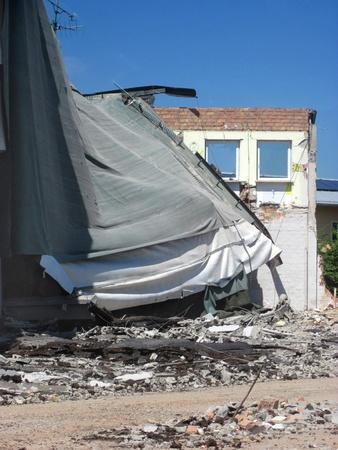 dismantling: Demolition, construction. Crane dismantling building.
