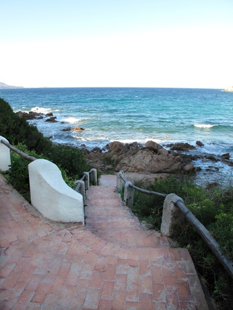 panoramics: Rocky beach with stairs and waves