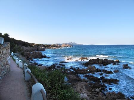 panoramics: Rocky beach with stairs and waves. Sardinia