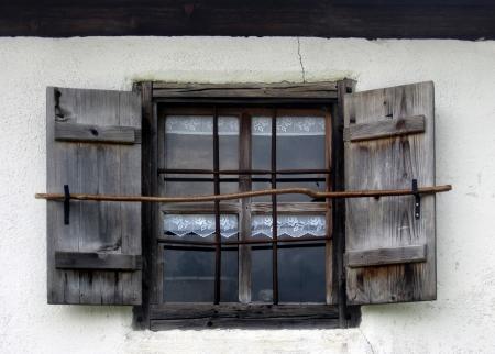 Vintage window with rusty decorative bars   photo