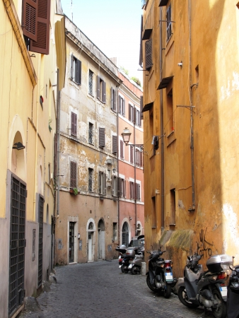 Row of the motorcycles on the old street in Roma photo