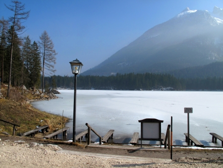 Frozen lake in winter with the Alpine mountain and blue sky  photo