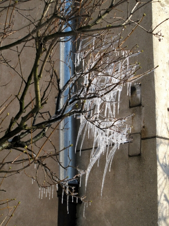 Icicles hang from rain gutters on a sunny winter day photo