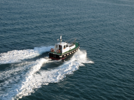 tug boat: The tug boat bow creating spray  Stock Photo