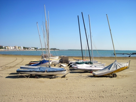 Boats on the empty beach  End of season  photo