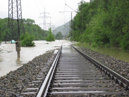 rail route: The Flooded Straight Railway Track with Timber Sleepers  Saalach, Germany Stock Photo