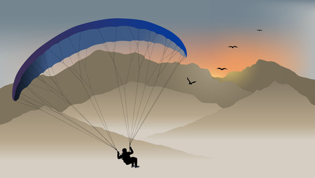 Para-glider hovers over the mountain like a bird