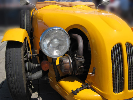 old timer: Front of a yellow old timer