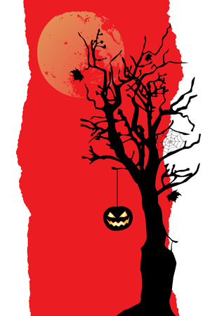 The pumpkin is hanging on the tree. Halloween background with place for your text