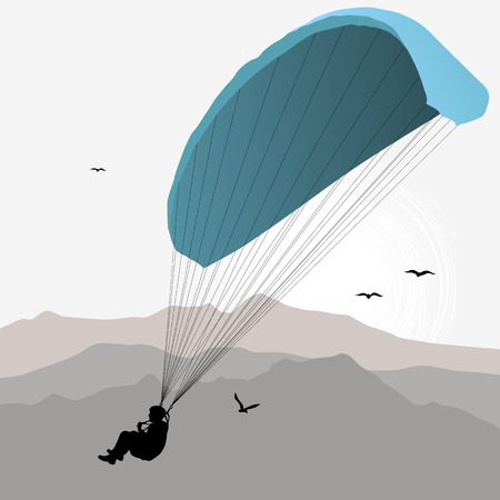 Paraglider hovers over the mountain like a bird