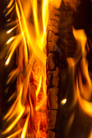 log fire: A burning log fire with glowing embers Stock Photo