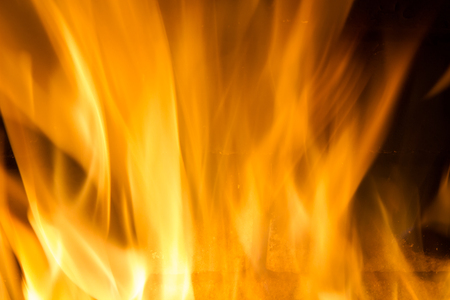 gas fireplace: Background on black forks of flames yellow orange and red