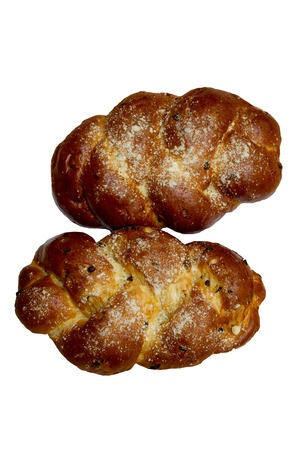 shabat: Two Shabbat challah on a white background