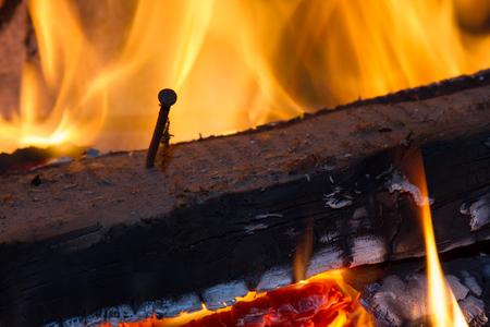 rusty nail: burning wood with nail