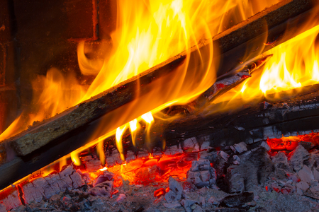 firewood: Burning firewood in the fireplace close up. Foto Stock Photo