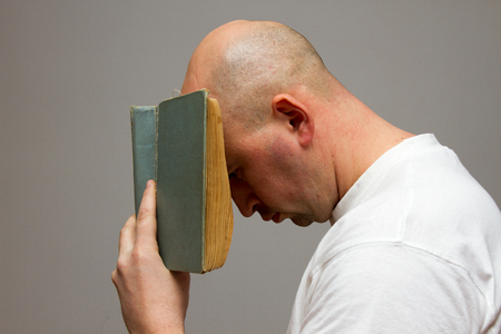 man buried his head in the old book