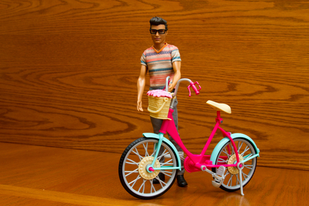 Doll with a bicycle
