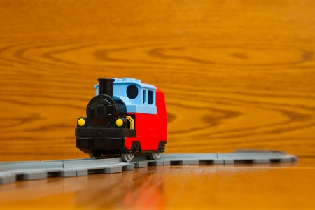 sleepers: A toy train rides on rails Stock Photo