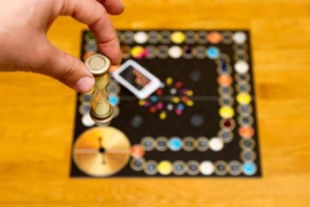 chess board: Board game. Hand with blue dice. casino