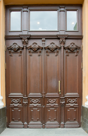 luxuriously: decorated wooden door