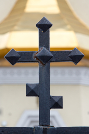 Black cross on the background of the church