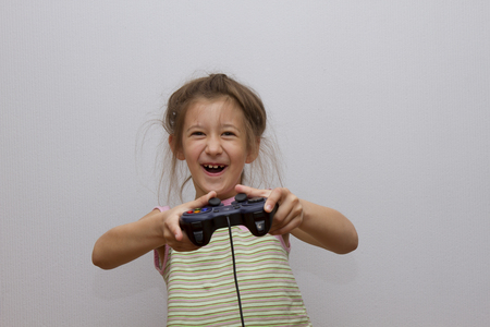 Happy Caucasian girl playing video games holding game controller
