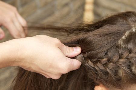 closeup of hands doing hair Stock Photo