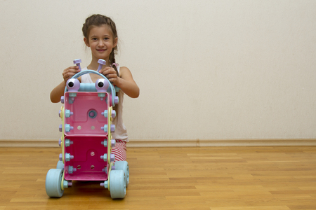 kidsroom: The girl made the robot out of the constructor