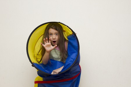 recess: little girl playing in the tunnel