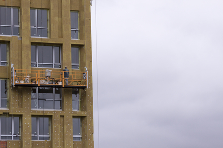 Warming of a high-rise building with mineral wool Stock Photo