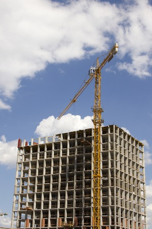 formatting: Crane and building construction on sky background Stock Photo