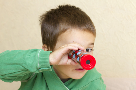 little boy with a kaleidoscope