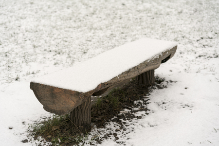 Wooden bench under the snow Stock Photo